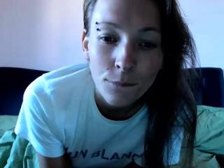 Tattooed brunette webcam solo