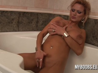 Busty MILF crazy play with bodyoil and masturbate by water when take shower